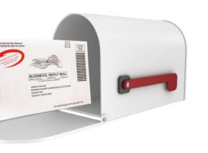 white mailbox with vote-by-mail envelope