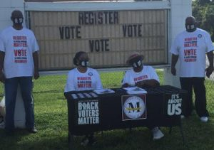 four people registering voters outside