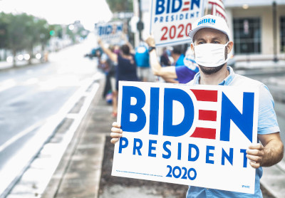 dan holbert holding biden for president 2020 sign at rally