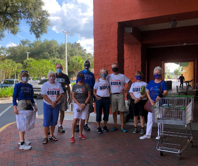 group of shoppers with biden shirts outside grocery