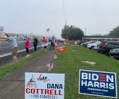 row of sign waving people